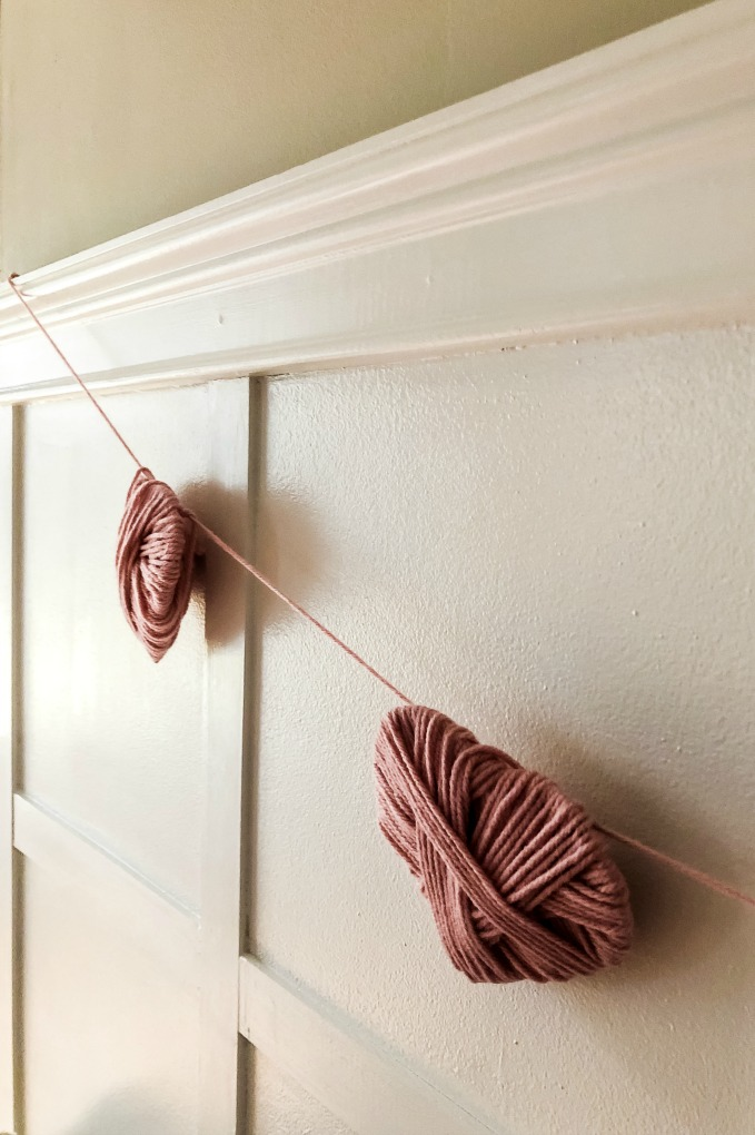 https://myfamilythyme.com/wp-content/uploads/2020/02/pink-yarn-heart-garland.jpg